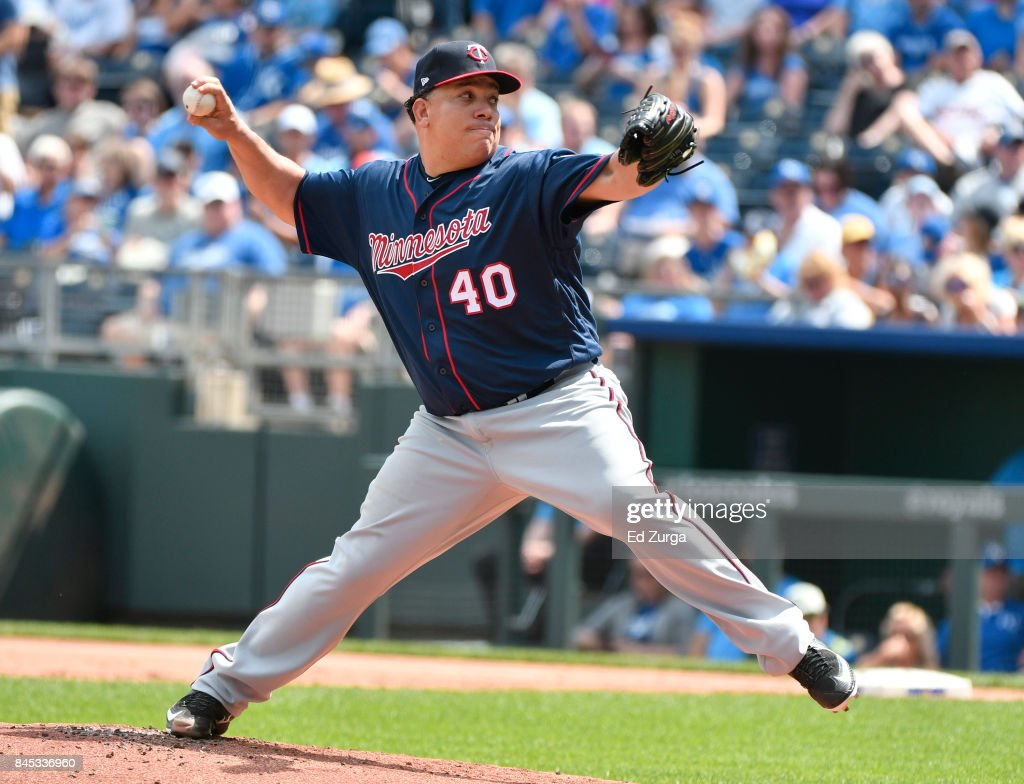 Bartolo Colon #40 of the Minnesota Twins throws in the first inning against the Kansas City Royals at Kauffman Stadium on September 10, 2017 in Kansas City, Missouri.