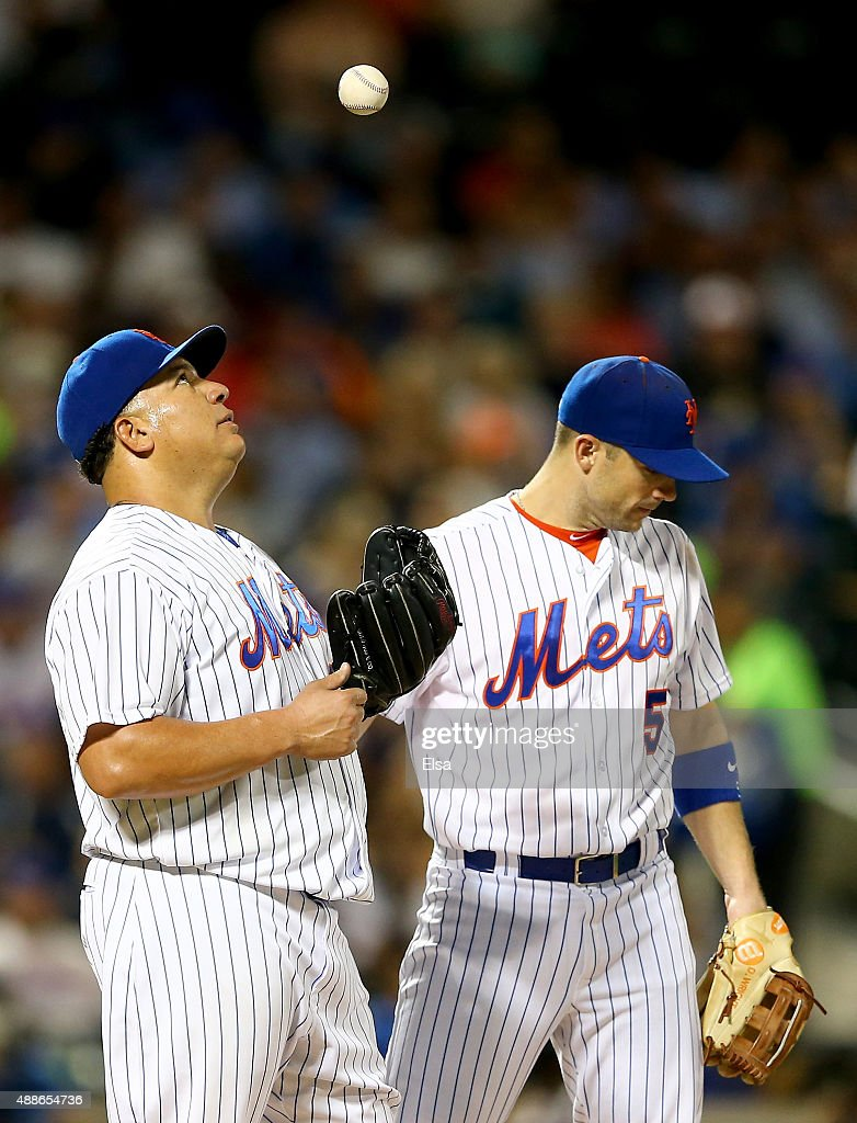 Bartolo Colon #40 of the New York Mets reacts while teammate David Wright #5 stands by as Colon is about to be pulled from the game in the sixth inning against the Miami Marlins on September 16, 2015 at Citi Field in the Flushing neighborhood of the Queens borough of New York City.