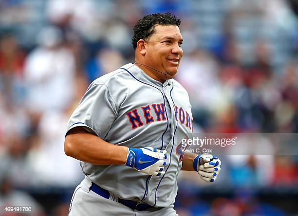 Bartolo Colon of the New York Mets runs to first base after hitting a RBI single into right field against the Atlanta Braves during the Braves...