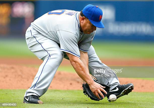 Bartolo Colon of the New York Mets scoops up a ground ball hit by Freddie Freeman of the Atlanta Braves in the second inning during the Braves...
