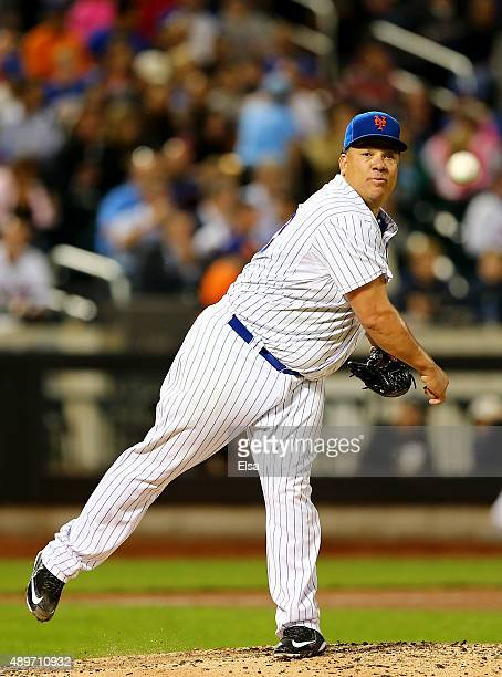 Bartolo Colon of the New York Mets tries to pick off a runner at first in the fourth inning against the Atlanta Braves on September 23 2015 at Citi...