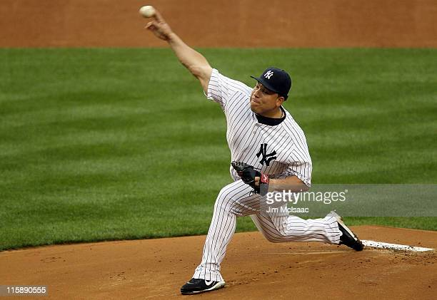Bartolo Colon of the New York Yankees delivers a pitch against the Cleveland Indians on June 11 2011 at Yankee Stadium in the Bronx borough of New...
