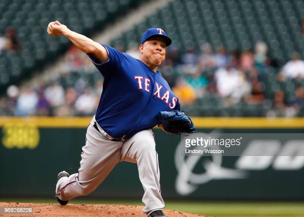 Bartolo Colon of the Texas Rangers delivers a pitch against the Seattle Mariners in the first inning at Safeco Field on May 16 2018 in Seattle...
