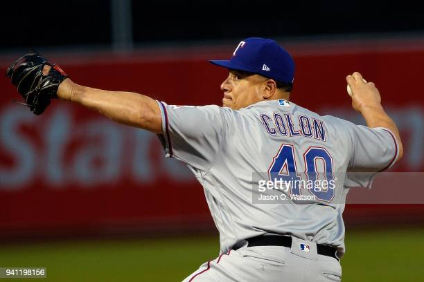 Bartolo Colon of the Texas Rangers pitches against the Oakland Athletics during the first inning at the Oakland Coliseum on April 2 2018 in Oakland...
