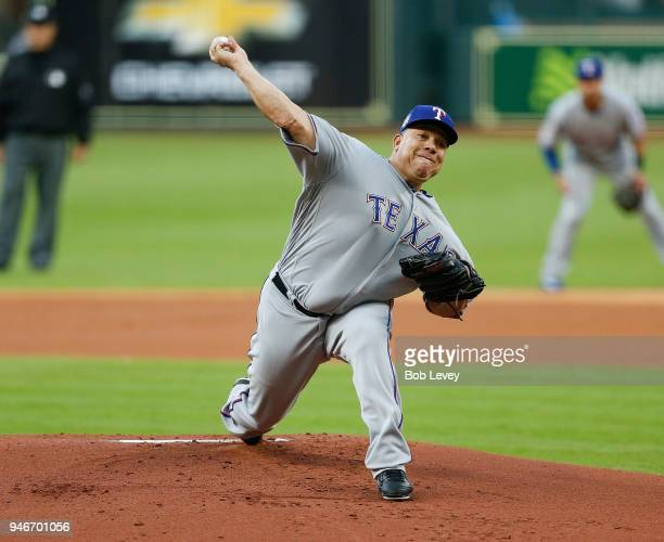 Bartolo Colon of the Texas Rangers pitches in the first inning against the Houston Astros at Minute Maid Park on April 15 2018 in Houston Texas All...