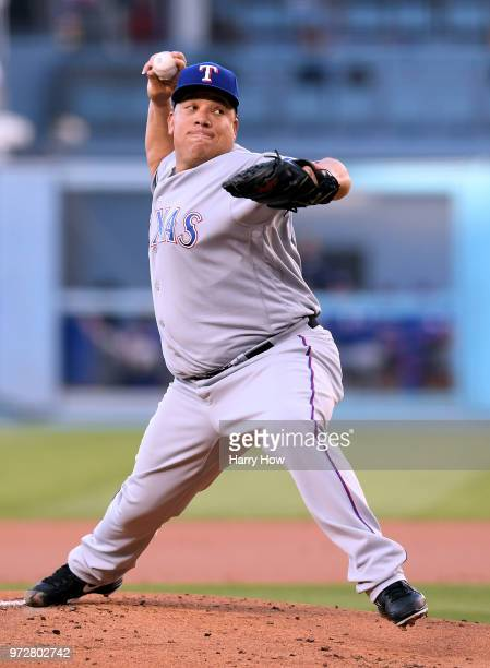 Bartolo Colon of the Texas Rangers pitches to the Los Angeles Dodgers during the first inning at Dodger Stadium on June 12 2018 in Los Angeles...