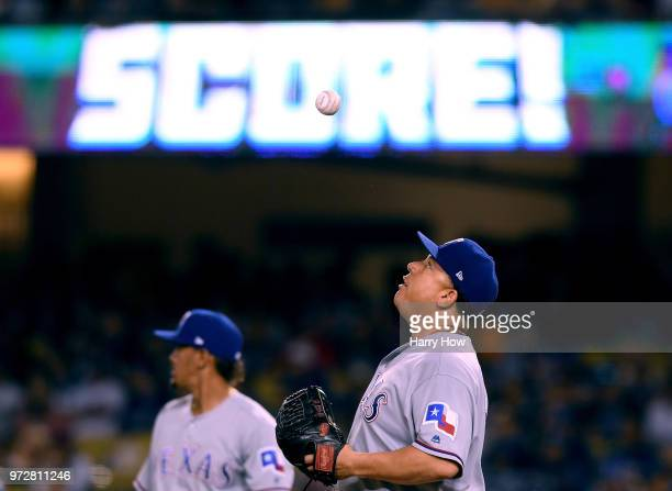 Bartolo Colon of the Texas Rangers reacts after a Chris Taylor of the Los Angeles Dodgers RBI single for a 72 lead during the fourth inning at Dodger...