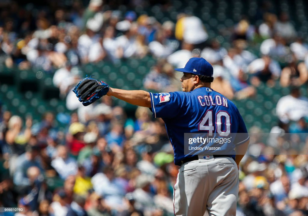 Bartolo Colon #40 of the Texas Rangers waves to fans as he is replaced in the eighth inning against the Seattle Mariners at Safeco Field on May 16, 2018 in Seattle, Washington.