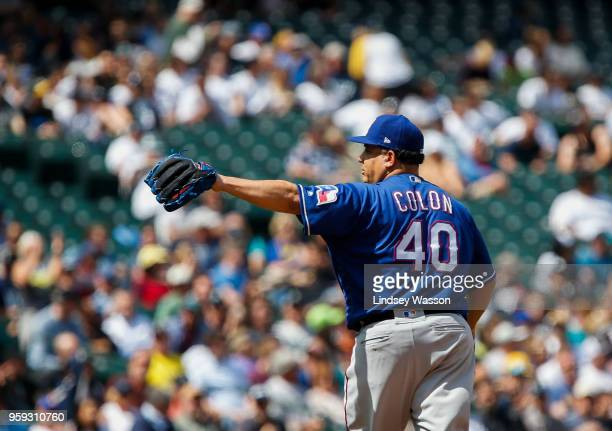 Bartolo Colon of the Texas Rangers waves to fans as he is replaced in the eighth inning against the Seattle Mariners at Safeco Field on May 16 2018...
