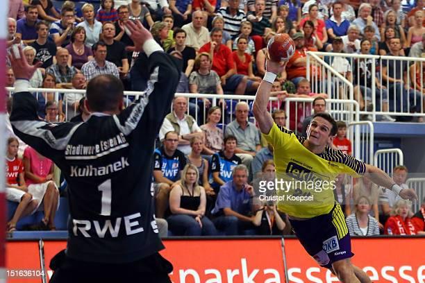Bartolomiej Jaszka of Berlin scores a goal against Jan Kulhanek of Essen during the DKB Handball Bundesliga match between TUSEM Essen and Fueches...