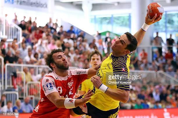 Bartolomiej Jaszka of Berlin scores a goal against Philipp Poeter of Essen during the DKB Handball Bundesliga match between TUSEM Essen and Fueches...