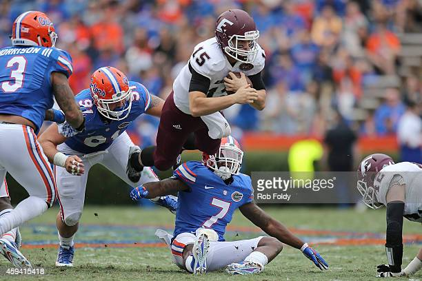 Barton Mann of the Eastern Kentucky Colonels dives for a first down during the first half of the game against the Florida Gators at Ben Hill Griffin...