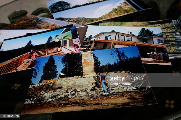 barton_060308_CFW Alisha Alitz displays photos of her home both after and before the Hayman fire She is at her new home in Turkey Rock Ranch in...