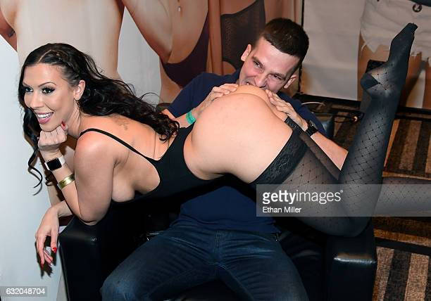 Bartosz Andrzejewski of Poland poses for a photo with adult film actress Rachel Starr at the Pornhub booth at the 2017 AVN Adult Entertainment Expo...