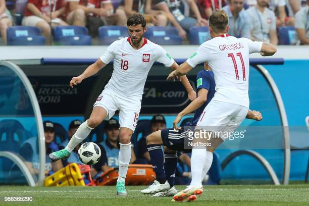Bartosz Bereszynski and Kamil Grosicki of Poland in action during the 2018 FIFA World Cup Russia group H match between Japan and Poland at Volgograd...