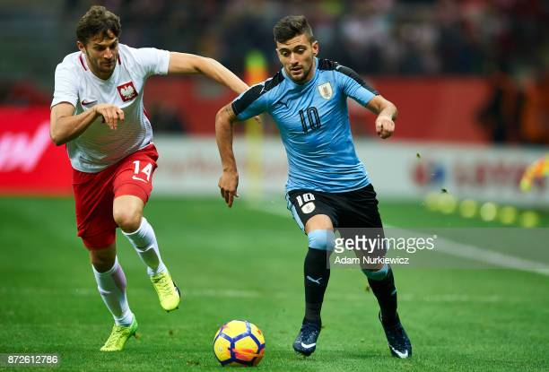 Bartosz Bereszynski from Poland fights for the ball with Giorgian De Arrascaeta from Uruguay during the international friendly between Poland and...