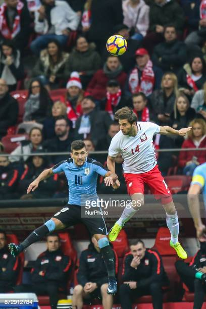 Bartosz Bereszynski Giorgian de Arrascaeta in action during the international friendly match between Poland and Uruguay at National Stadium on...