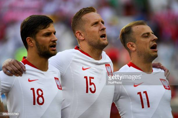 Bartosz Bereszynski Kamil Glik and Kamil Grosicki of Poland during the 2018 FIFA World Cup Group H match between Japan and Poland at Volgograd Arena...