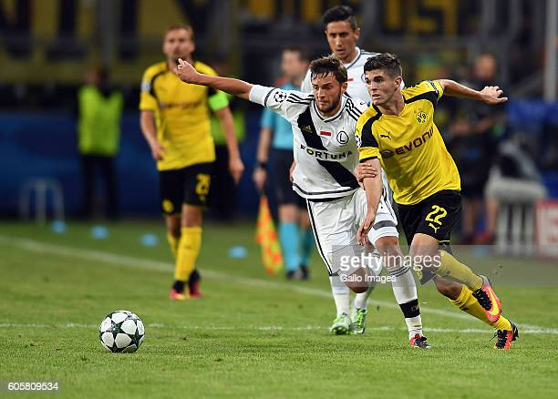 OUT Bartosz Bereszynski of Legia Warszawa Christian Pulisic of Borussia Dortmmund in action during the Group Stage of the UEFA Champions League match...