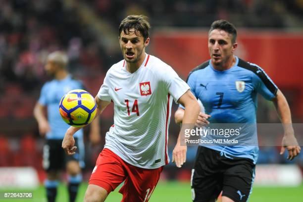 Bartosz Bereszynski of Poland and Cristian Rodriguez of Uruguay during the international friendly match between Poland and Uruguay at National...
