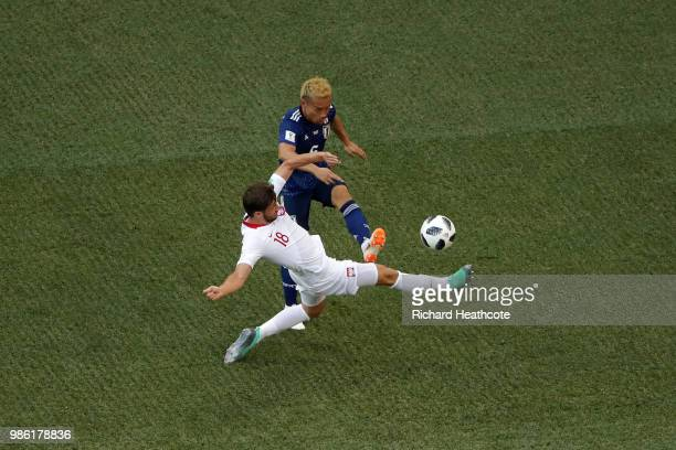 Bartosz Bereszynski of Poland tackles Yuto Nagatomo of Japan during the 2018 FIFA World Cup Russia group H match between Japan and Poland at...
