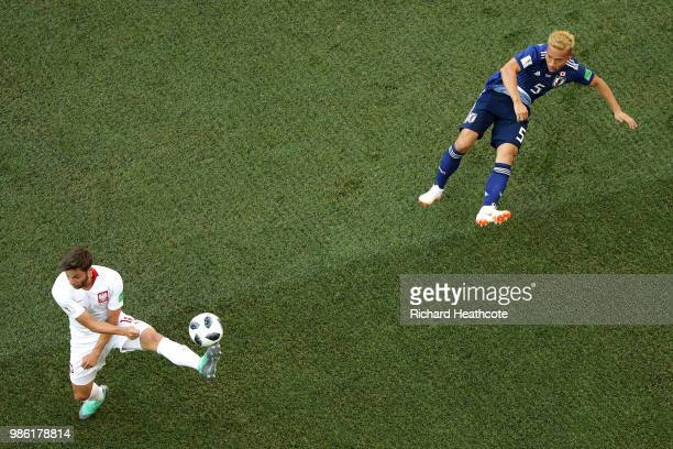 Bartosz Bereszynski of Poland tries to block a cross from Yuto Nagatomo of Japan during the 2018 FIFA World Cup Russia group H match between Japan...