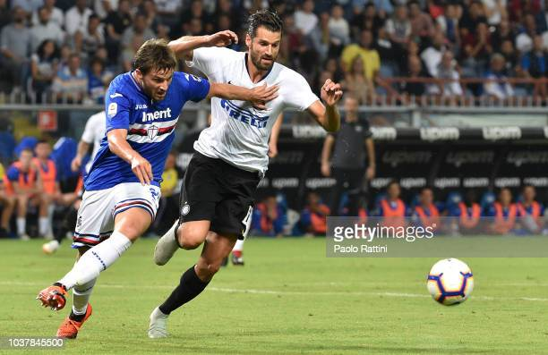 Bartosz Bereszynski of Sampdoria opposed to Antonio Candreva of Inter during the serie A match between UC Sampdoria and FC Internazionale at Stadio...