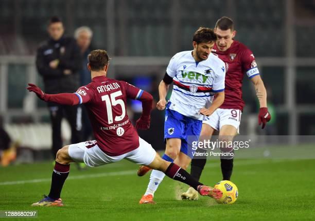 Bartosz Bereszynski of U.C. Sampdoria battles for possession with Cristian Ansaldi of Torino F.C. And Andrea Belotti of Torino F.C. During the Serie...