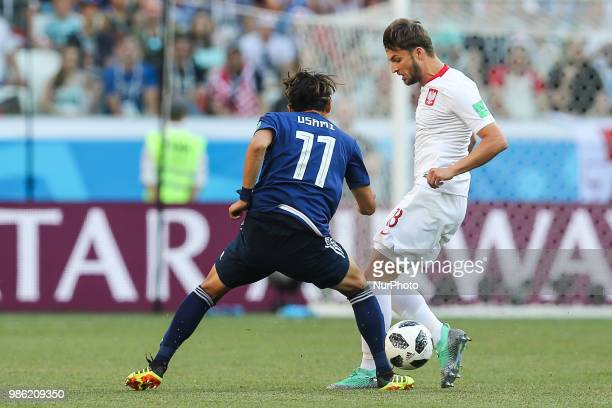 Bartosz Bereszynski Takashi Usami during the 2018 FIFA World Cup Russia group H match between Japan and Poland at Volgograd Arena on June 28 2018 in...