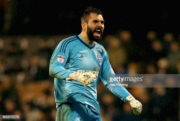 Bartosz Bialkowski of Ipswich celebrates after his side score their first during the Sky Bet Championship match between Fulham and Ipswich Town at...