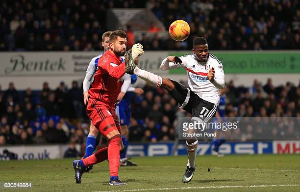 Bartosz Bialkowski of Ipswich Town and Floyd Ayite of Fulham compete for the ball during the Sky Bet Championship match between Ipswich Town and...