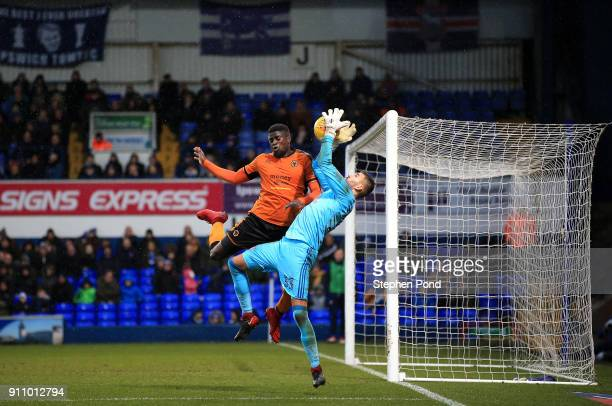 Bartosz Bialkowski of Ipswich Town and Ivan Cavaleiro of Woverhampton Wanderers compete for the ball during the Sky Bet Championship match between...