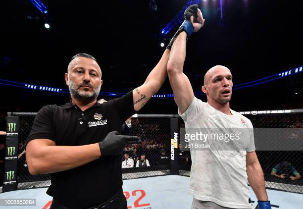 Bartosz Fabinski of Poland celebrates after his victory over Emil Meek of Norway in their welterweight bout during the UFC Fight Night at Barclaycard...