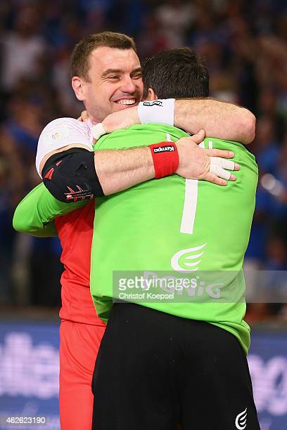 Bartosz Jurecki embraces po01 of Poland after the third place match between Poland and Spain in the Men's Handball World Championship at Lusail...