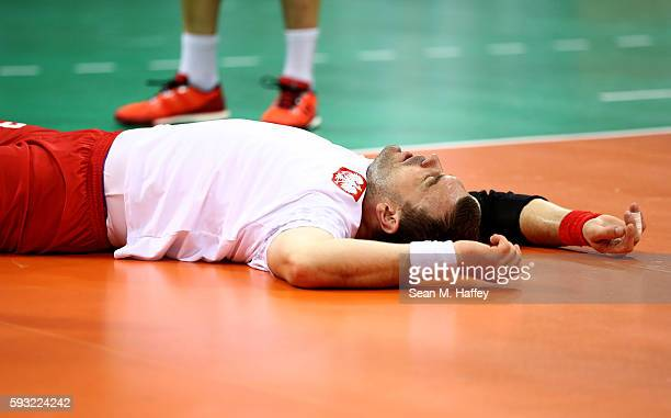 Bartosz Jurecki lies on the ground during the Men's Bronze Medal Match between Poland and Germany on Day 16 of the Rio 2016 Olympic Games at Future...