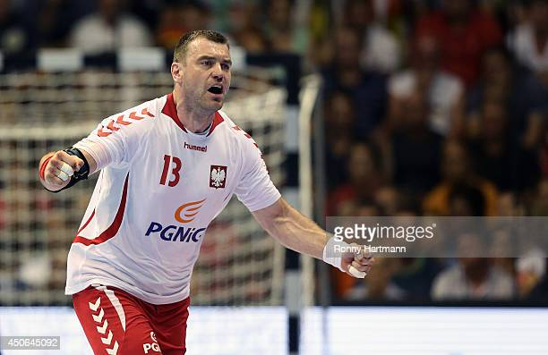 Bartosz Jurecki of Poland celebrates scoring during the IHF World Championship 2015 Playoff Leg Two between Germany and Poland at GetecArena on June...