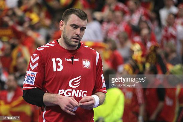 Bartosz Jurecki of Poland looks dejected after losing 2527 the Men's European Handball Championship second round group one match between Poland and...