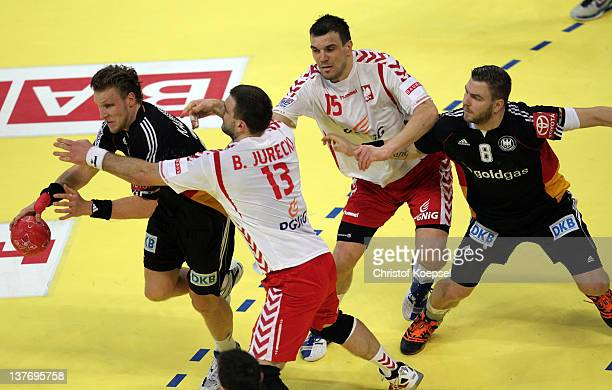 Bartosz Jurecki pol and Michal Jurecki of Poland defend against Lars Kaufmann of Germany and Christoph Theuerkauf of Germany during the Men's...