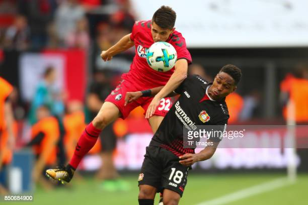Bartosz Kapustka and Wendellbattle for the ball during the Bundesliga match between Bayer 04 Leverkusen and SC Freiburg at BayArena on September 17...