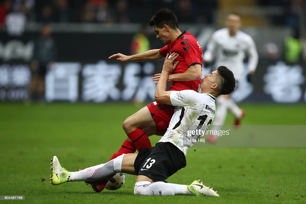 Bartosz Kapustka of Freiburg (l) is challenged by Carlos Salcedo of Frankfurt during the Bundesliga match between Eintracht Frankfurt and Sport-Club Freiburg at Commerzbank-Arena on January 13, 2018 in Frankfurt am Main, Germany.