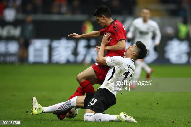 Bartosz Kapustka of Freiburg is challenged by Carlos Salcedo of Frankfurt during the Bundesliga match between Eintracht Frankfurt and SportClub...