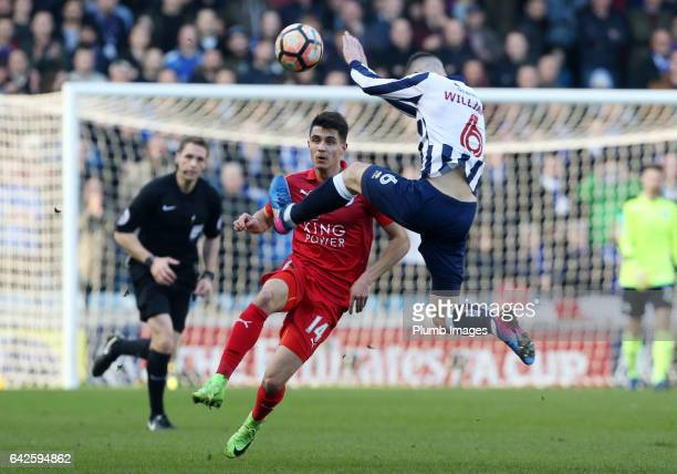 Bartosz Kapustka of Leicester City in action with Shaun Williams of Millwall during of The Emirates FA Cup Fifth Round tie between Millwall and...