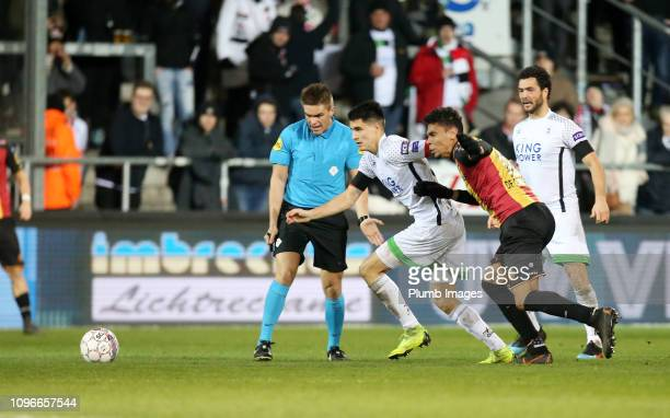 Bartosz Kapustka of OH Leuven competes for the ball with Igor De Camargo of KV Mechelen during the Proximus League match between KV Mechelen and OH...