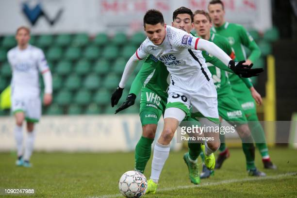 Bartosz Kapustka of OH Leuven in action with Soufiane El Banouhi of Lommel SK during the Proximus League match between Lommel SK and OH Leuven at...