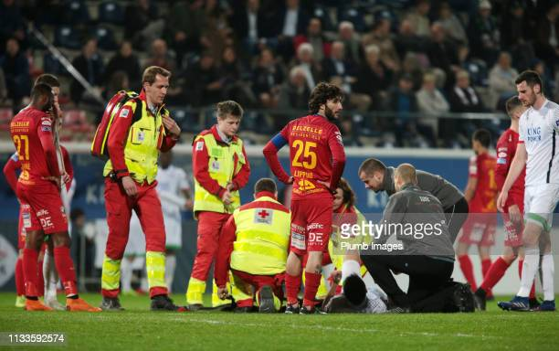 Bartosz Kapustka of OH Leuven receives treatment before having to be stretchered off during the Proximus League play down match between OH Leuven and...