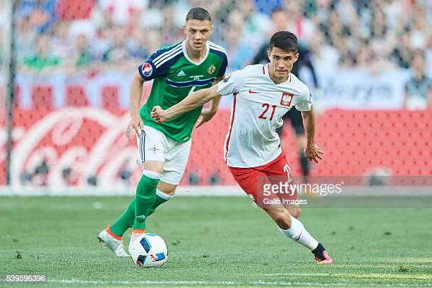 Bartosz Kapustka of Poland and Chris Baird of Northern Ireland during the UEFA Euro 2016 group C match between Poland and Northern Ireland at the...