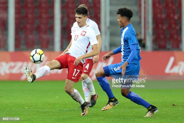 Bartosz Kapustka of Poland and Nicholas Hamalainen of Finland during the 2019 UEFA European Under21 Championship qualification game between Poland...