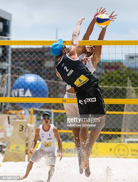 Bartosz Losiak of Poland spikes the ball against Saymon Barbosa of Brasil during the main draw match against at Pajucara beach during day five of the...