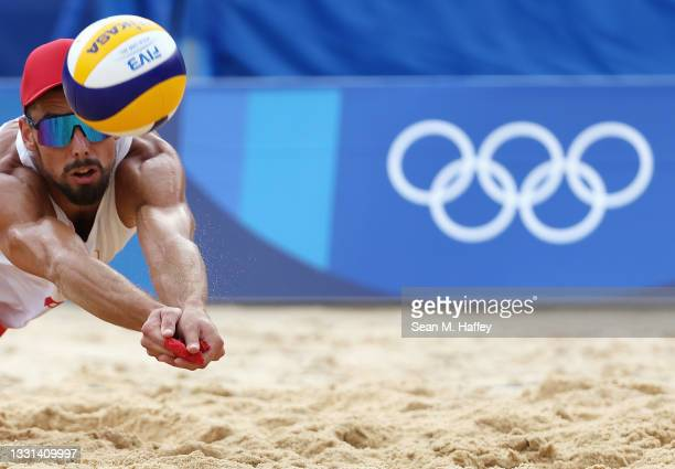 Bartosz Losiak of Team Poland competes against Team Italy during the Men's Preliminary - Pool F beach volleyball on day seven of the Tokyo 2020...