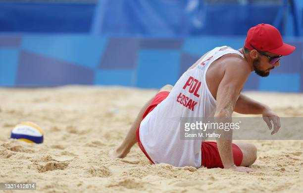 Bartosz Losiak of Team Poland reacts as he competes against Team Italy during the Men's Preliminary - Pool F beach volleyball on day seven of the...